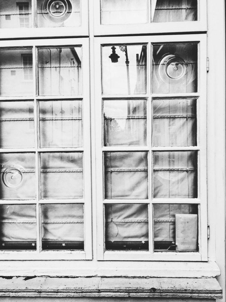 Street lantern reflected in a closed window