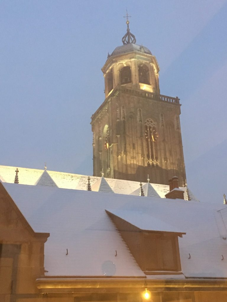 Church covered in snow by night